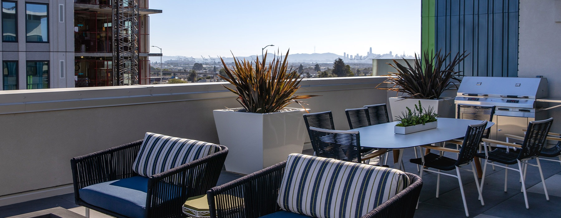 Rooftop patio space with a view of the city